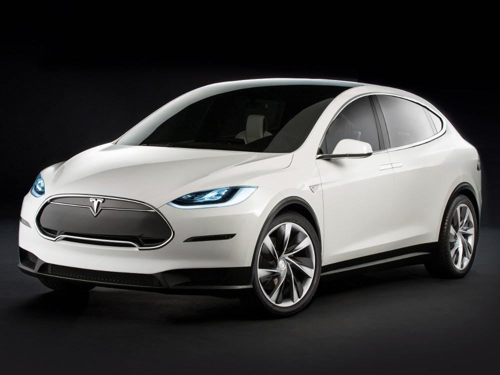 Tesla Model X Concept, déjà extrêmement fidèle au modèle définitif, à l'exception de la face avant légèrement remaniée, la calandre disparaissant sur le modèle de série.