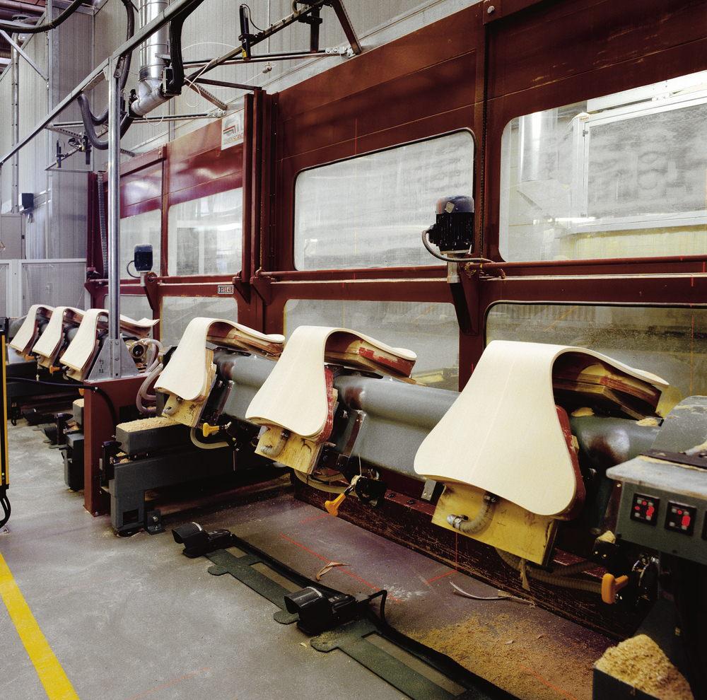 FCA Vassingerød Fritz Hansen factory - stackable chairs 3107 shells - in front: cut into final shape