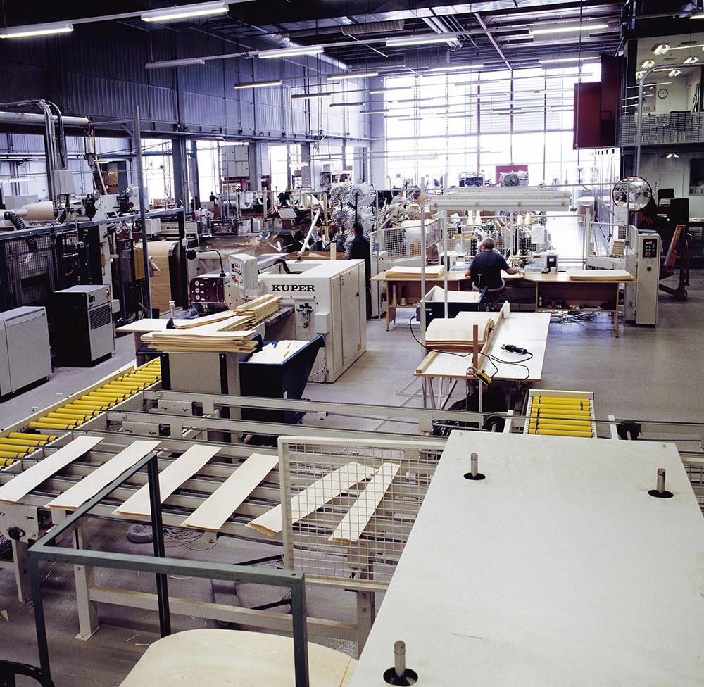 FCA Vassinger¯d Fritz Hansen factory - stackable chairs sticks  of veneer ready for edge-glueing