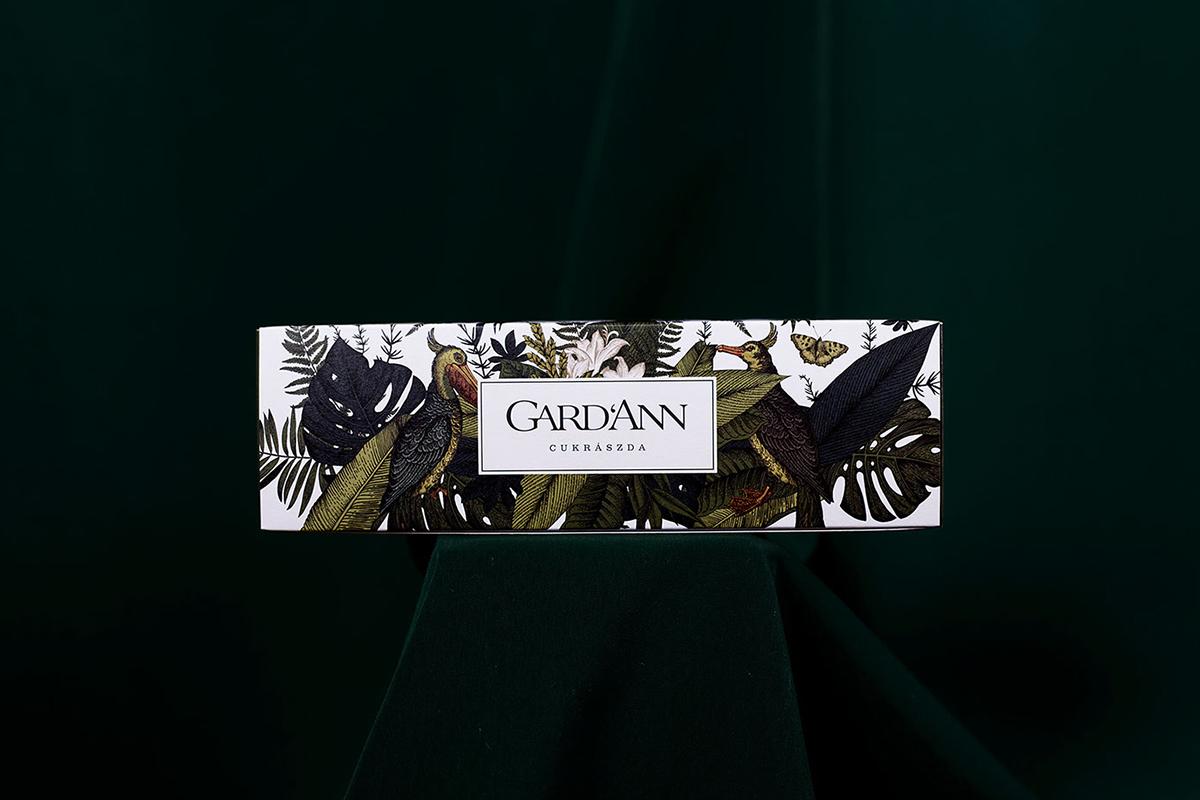 L'identité visuelle, le design d'espace et le packaging de Gard'Ann Patisserie par le studio Kissmiklos .